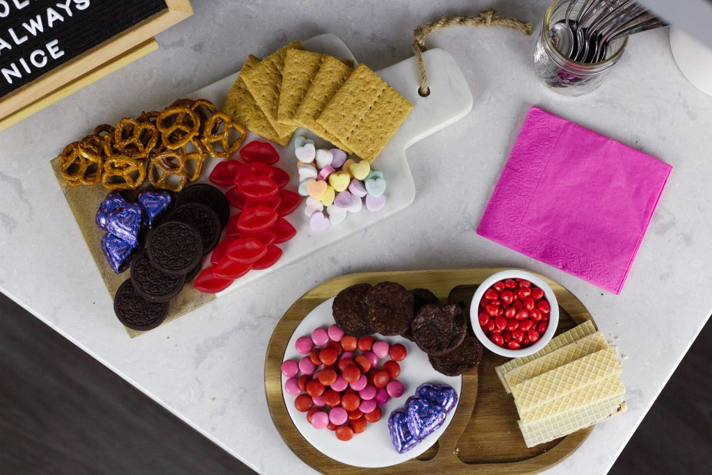 Valentines Day charcuterie board filled with candy and treats