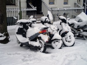 Snow-covered scooters by Elsie esq. on Flickr