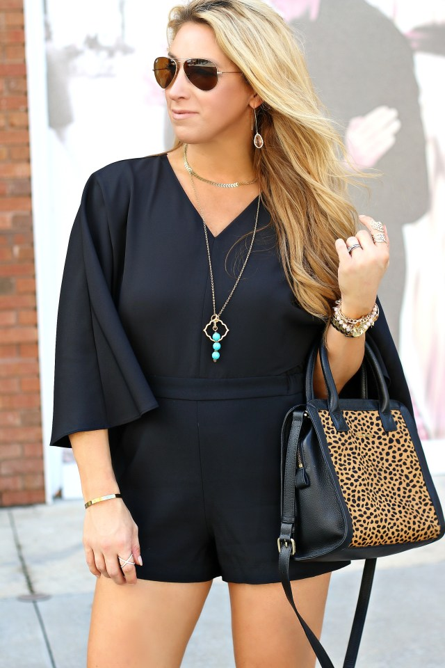 caped black romper