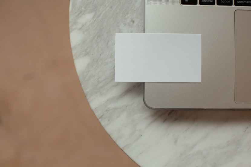 blank business card on laptop