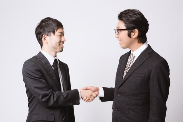 two Japanese business persons