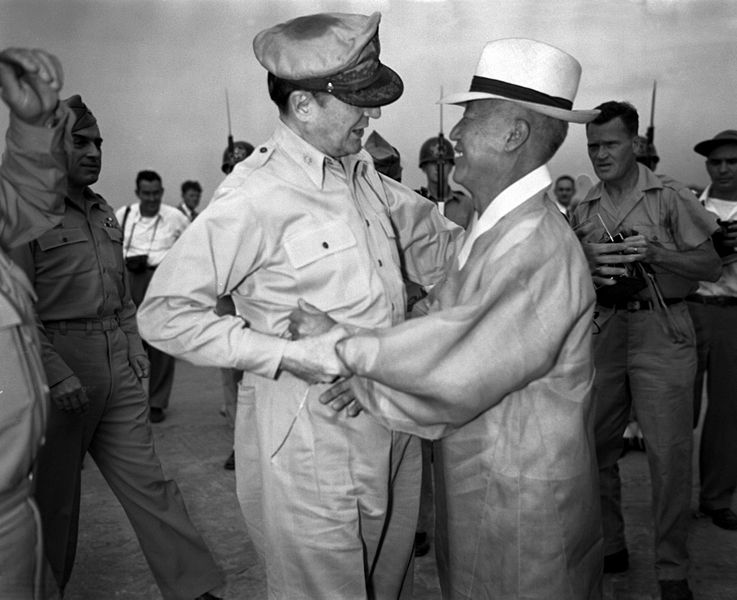 Syngman Rhee embraces Douglas MacArthur, General of the U.S. Army, upon being made leader of south Korea.