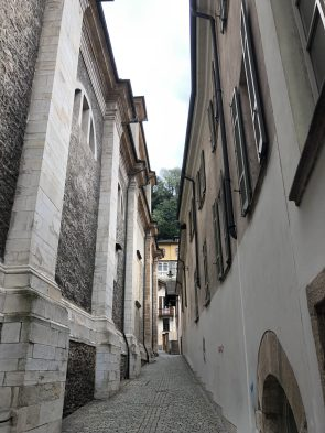 via narrow alleys