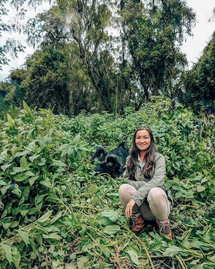 Girl gorilla trekking in Volcanoes National Park Rwanda