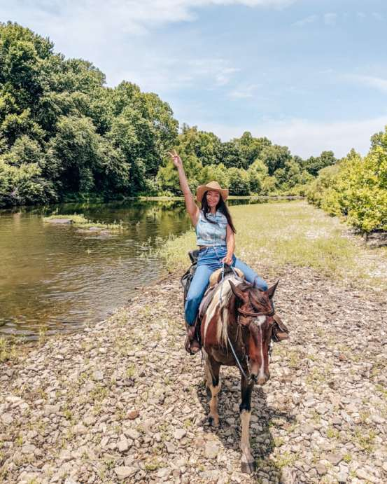 Horse back riding riverman