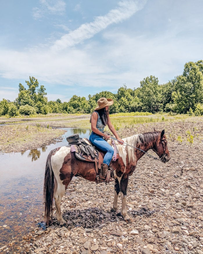 Horse back riding riverman