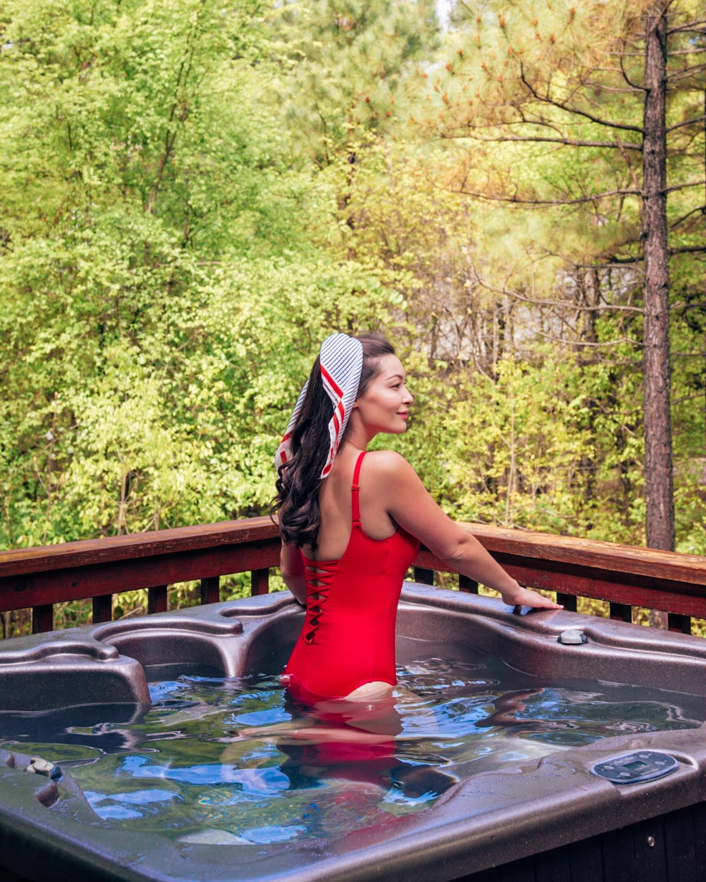 girl in hot tub in forest