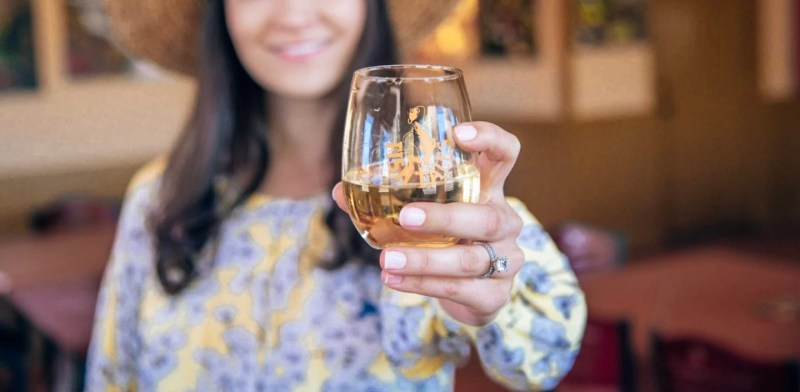 girl holding up wine glass