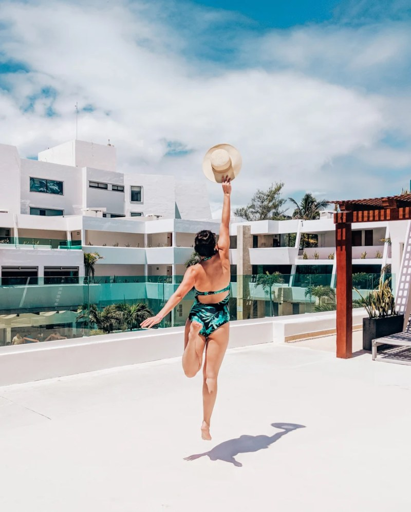 jumping for joy at a resort in Cancun, Mexico