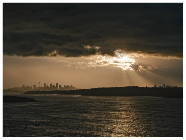 A moment between storms moving through Sydney allowed the sunlight to break through, illuminating the falling rain in a golden glow.