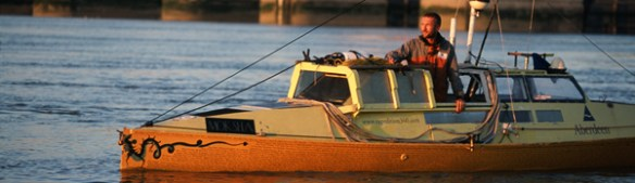 Adventurer Jason Lewis in his human-powered boat Moksha about to recross the Greenwich Meridian Line