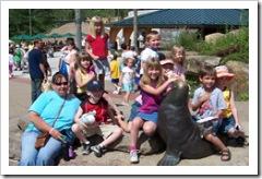 Kids pose with Grandma at the Kids Kingdom