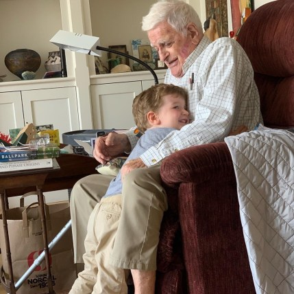 Boy and great-grandfather hugging
