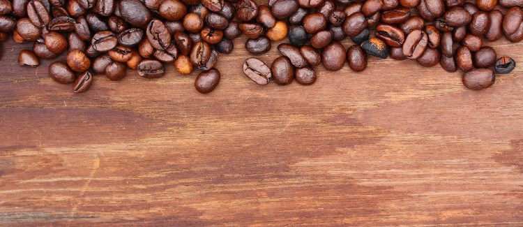 Coffee beans over wood block