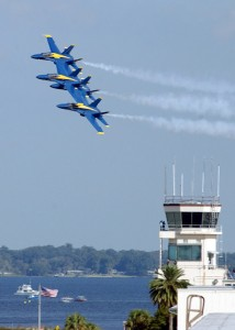 The Blue Angels fly in formation around the Operations Tower aboard Naval Air Station, Jacksonville. photo credit: Darryl Herring