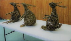 willow hare sculptures x 3 sitting on a table