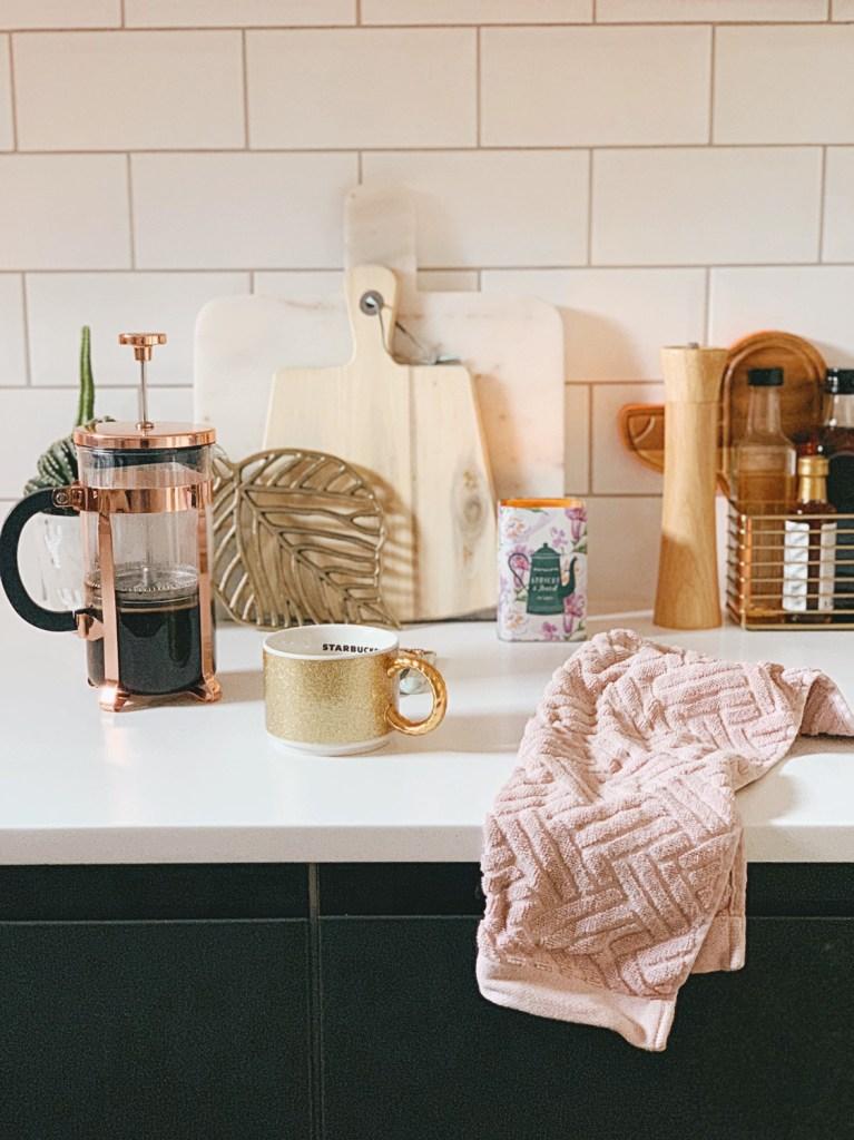 copper glass cafetiere gold glitter mug pink tea towel kitchen subway tiles.