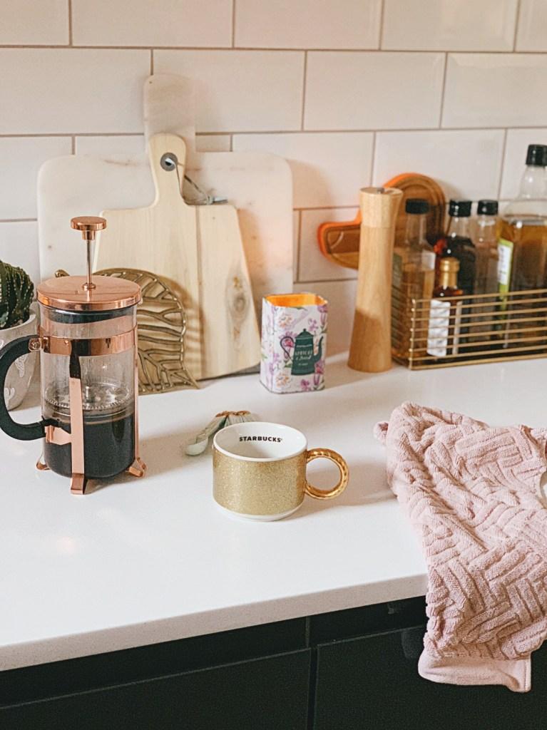 kitchen subway tile copper cafetiere starbucks mug pink towel