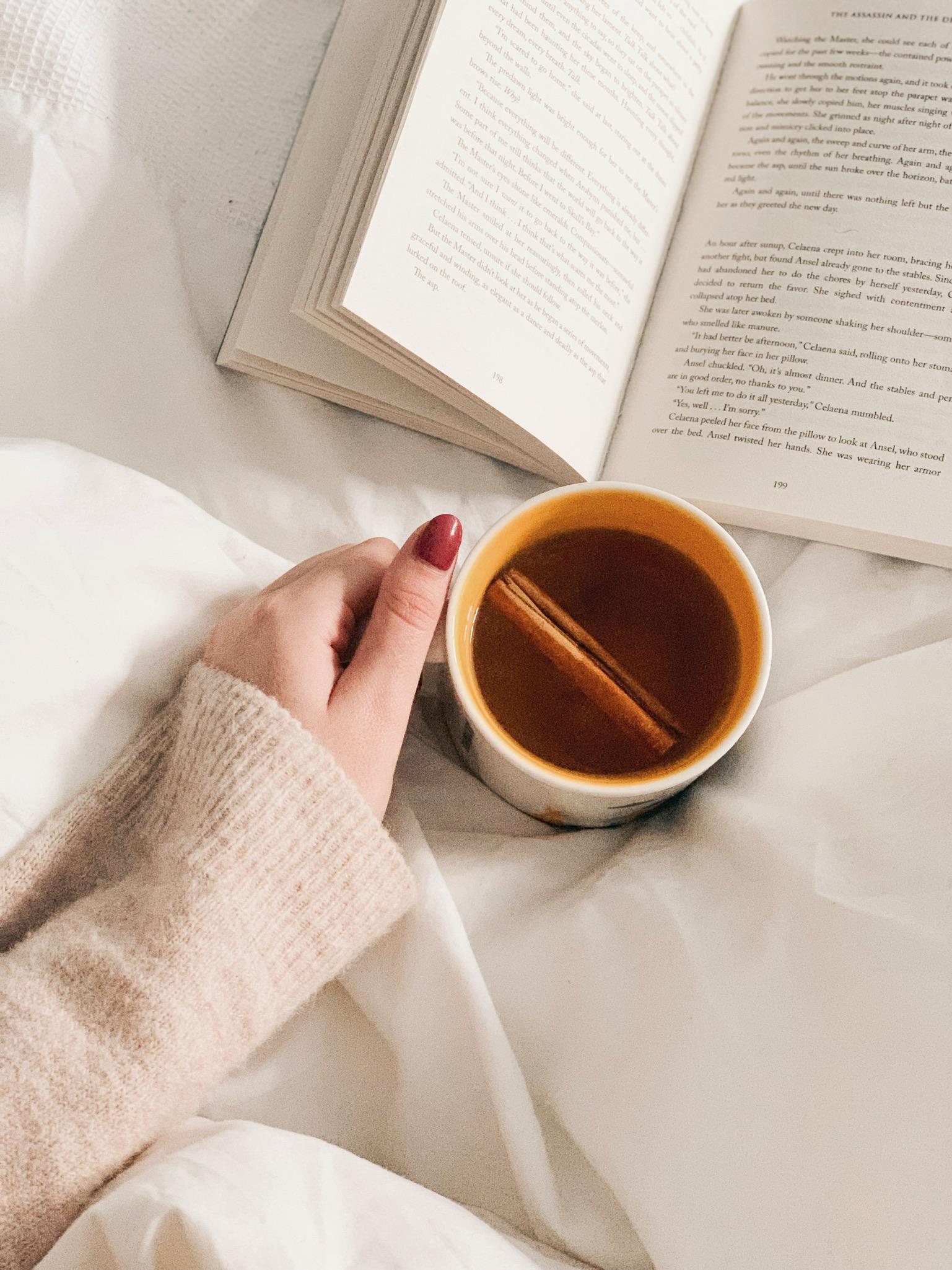 Jaye Rockett tea book bed flatlay