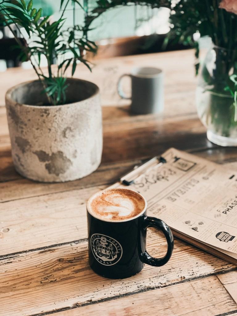 Jaye rockett South coast roast coffee shop bournemouth chai latte plants wood table