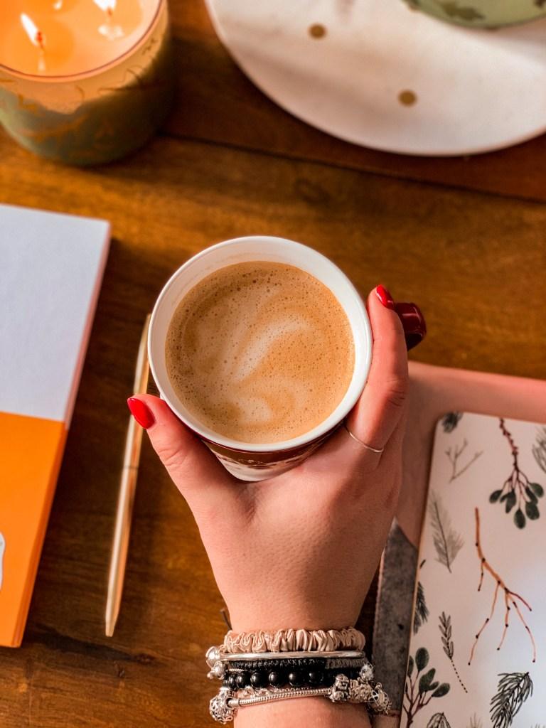 rhythm vs routine jaye rockett coffee desk setup diary laptop candle