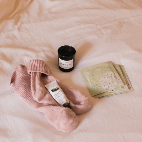 Lockdown loves jaye rockett flatlay candle socks beauty products on bed