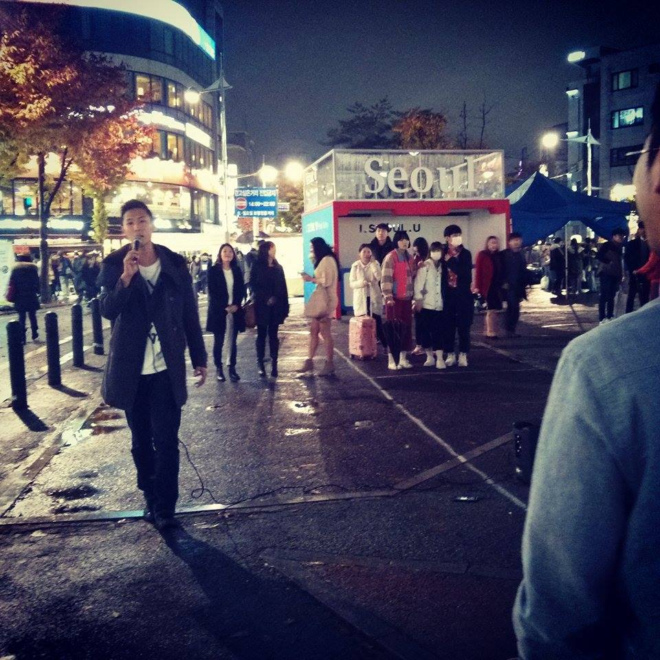 Serenades are common while walking around Hongdae on a weekend night.