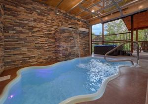 Big Sky Lodge is a luxury two bedroom cabin in Gatlinburg's Elk Spring Resort. It features an indoor pool, theater room, and an amazing master bath with walk-in shower and copper soaking tub