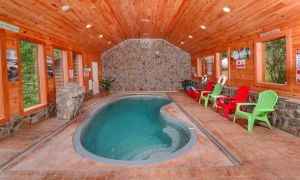 Holiday Springs features an incredible private pool in its detached pool house, theater room, basketball court, secluded privacy, and a mountain view in Gatlinburg