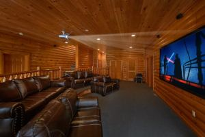 Movie Room Retreat is a luxury eight bedroom cabin in Pigeon Forge that features a theater room, Mountain View, huge bedrooms, and more