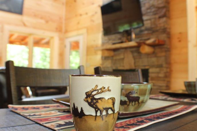 Elk mug at the dining table of Poolin' Around. A luxury rental cabin in Pigeon Forge