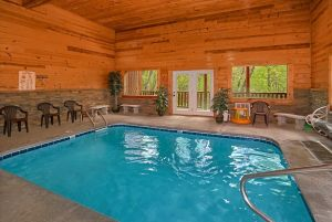 Swimming in Paradise is a three bedroom cabin rental with a private heated indoor pool and theater room