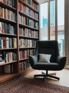 Chair in front of shelves full of books