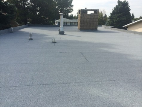 positive-slope insulation package for a residential flat roof