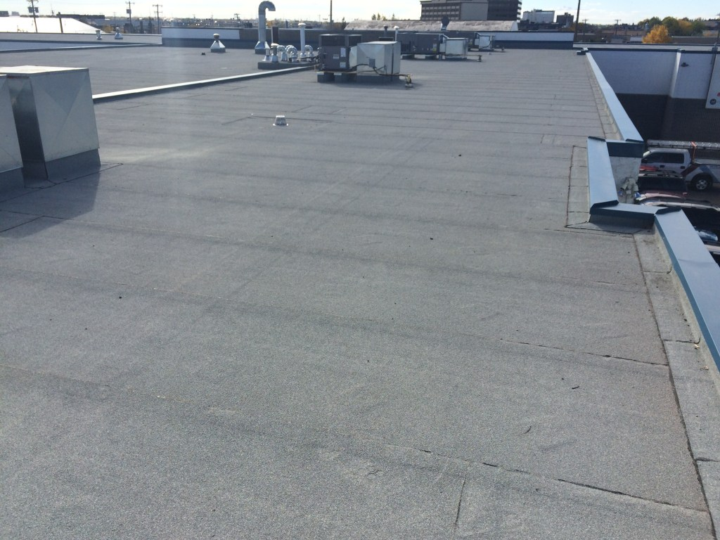 replacing tar and gravel roof with membrane in Edmonton