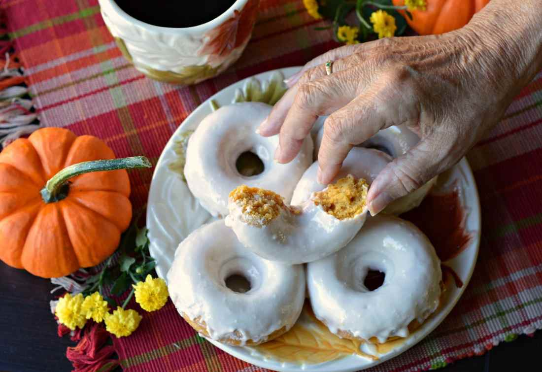Baked Buttermilk Pumpkin Donuts Hand Grabbing Donut. Calling all pumpkin lovers! Try my moist Baked Buttermilk Pumpkin Donut Recipe. Frosted with cream cheese and baked to perfection in my No Yeast Recipe.