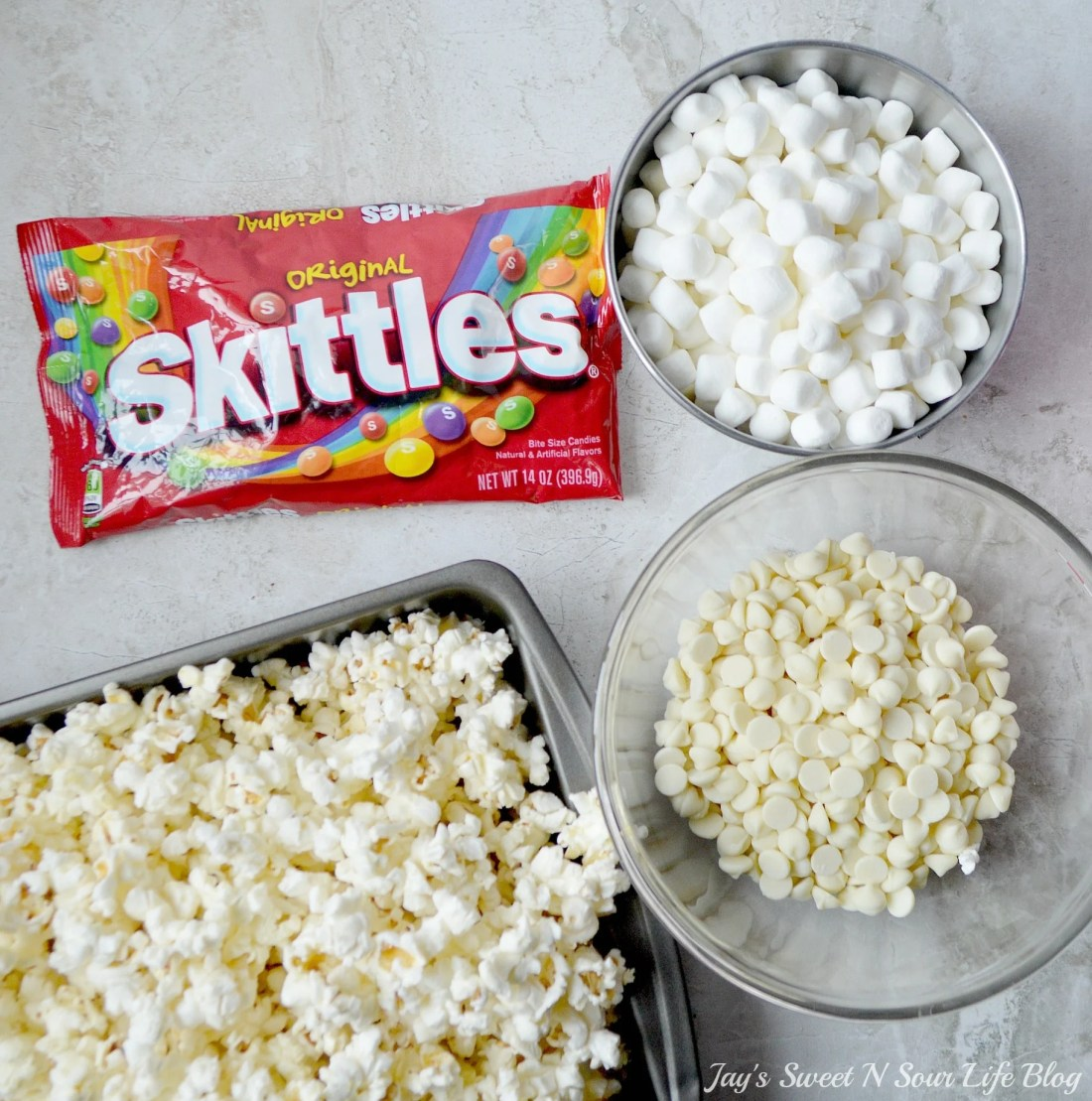 Game Day Skittles Inspired Snacks popcorn ingredients. Game Day Skittles Inspired Snacks that all of your friends and family can enjoy! Recipes include skittles popcorn, football cupcakes and more!
