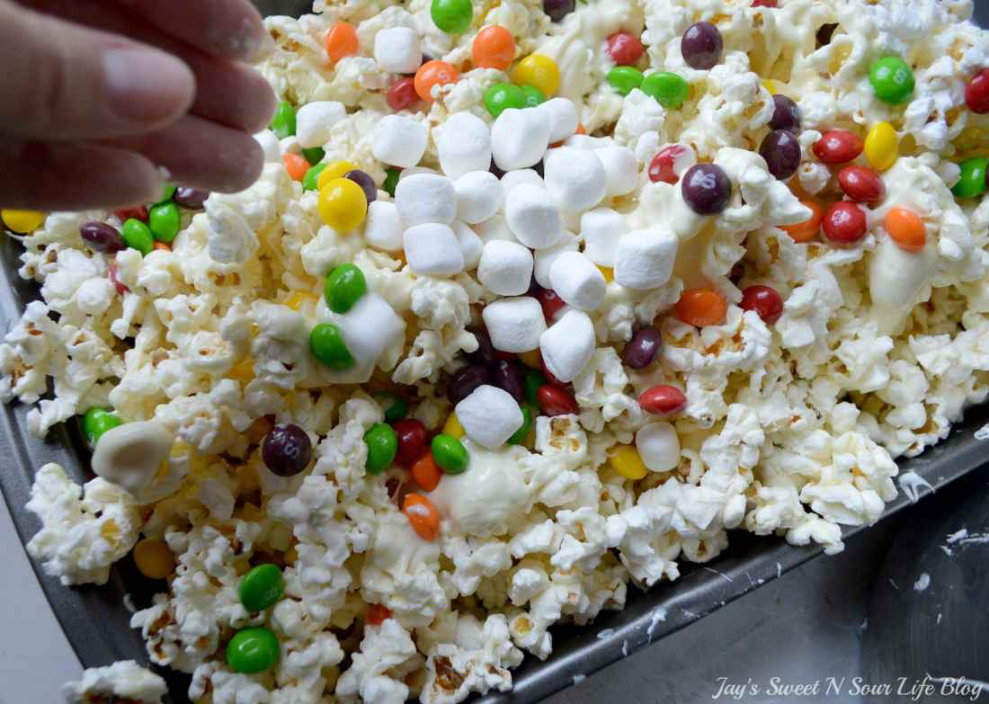 Game Day Skittles Inspired Snacks popcorn step 10. Game Day Skittles Inspired Snacks that all of your friends and family can enjoy! Recipes include skittles popcorn, football cupcakes and more!