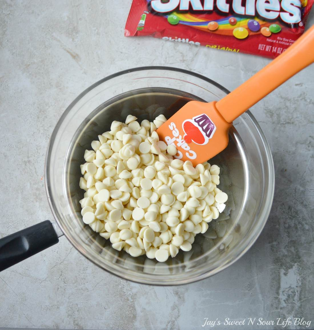 Game Day Skittles Inspired Snacks popcorn step 3. Game Day Skittles Inspired Snacks that all of your friends and family can enjoy! Recipes include skittles popcorn, football cupcakes and more!