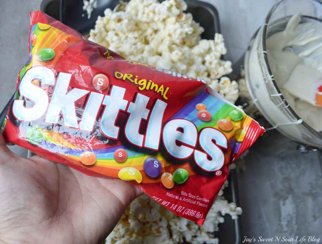 Game Day Skittles Inspired Snacks popcorn step 7. Game Day Skittles Inspired Snacks that all of your friends and family can enjoy! Recipes include skittles popcorn, football cupcakes and more!