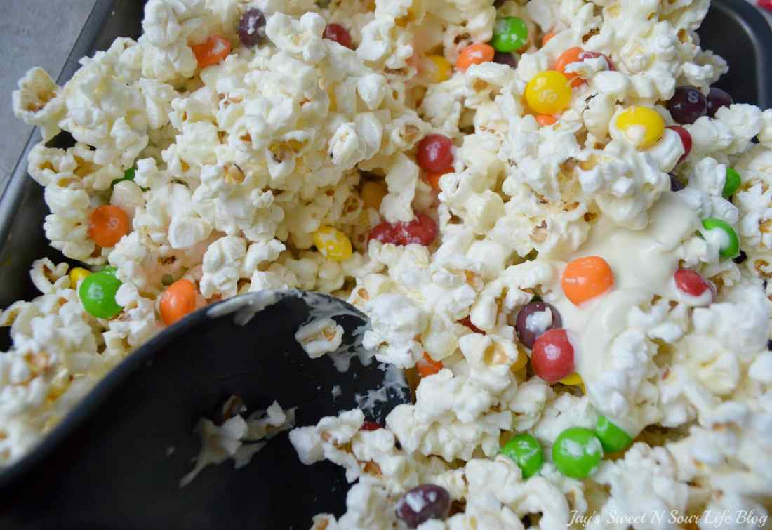 Game Day Skittles Inspired Snacks popcorn step 9. Game Day Skittles Inspired Snacks that all of your friends and family can enjoy! Recipes include skittles popcorn, football cupcakes and more!