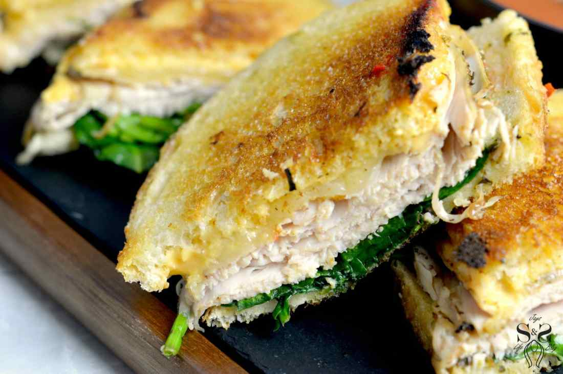 Turkey Pesto Grilled Cheese Sandwic closeup. If you are looking for that restaurant quality bistro sandwich, look no further. Bring the bistro home when you try my Turkey Pesto Grilled Cheese.