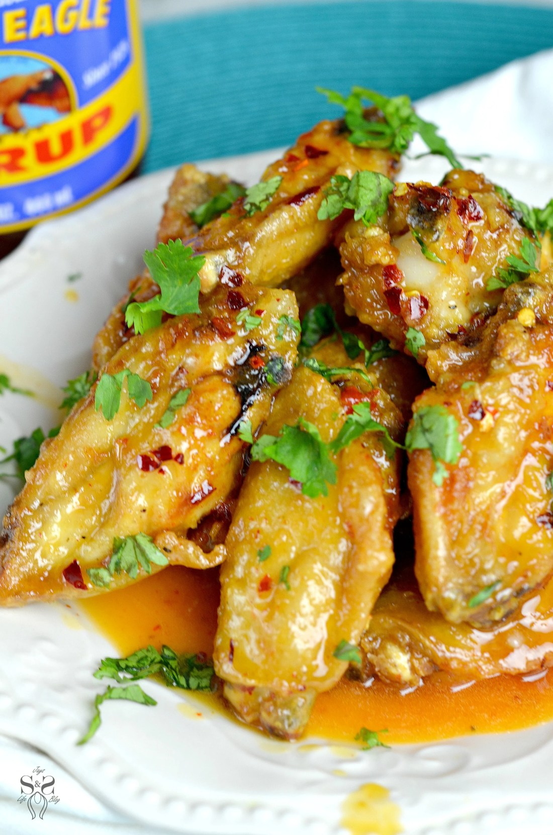 Spicy Buttery Chicken Wings Closeup Plate. Perfect for any night, these Spicy Buttery Chicken Wings are so easy to make and oh so delicious.