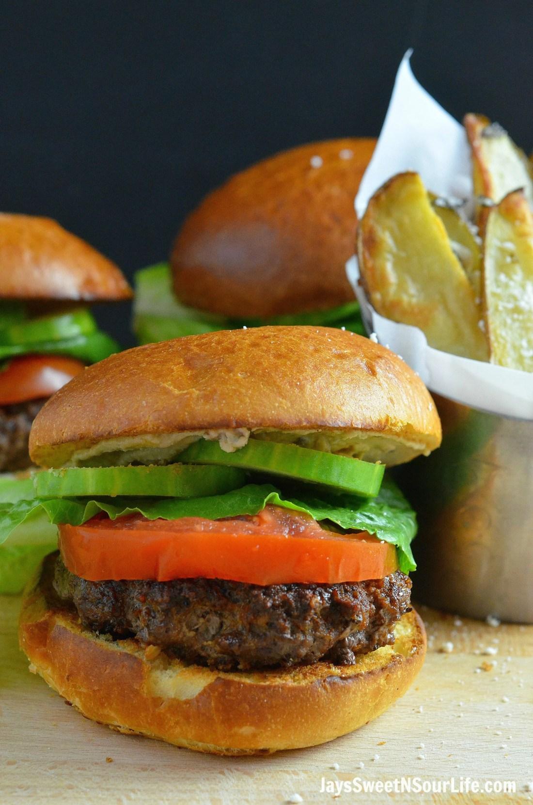 Mediterranean Bison Burger and Fries Closeup. Deck the halls and your home with the smell of delicious fresh made Mediterranean Bison Burger and fries using Boar's Hummus as a spread.