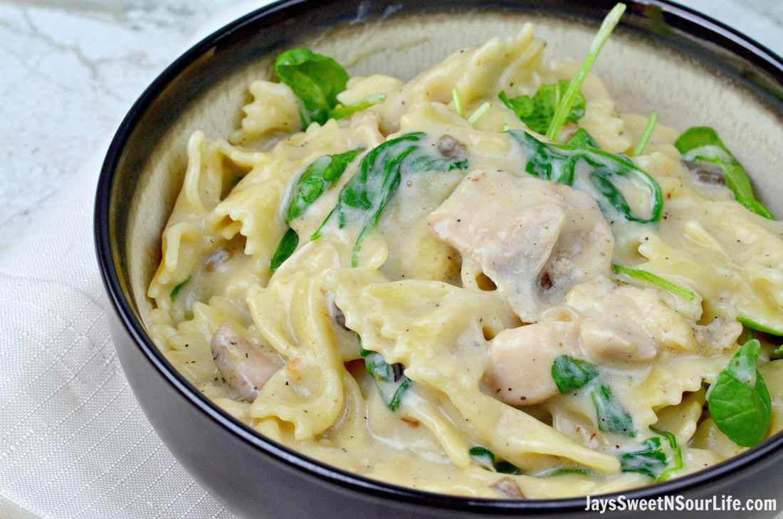 Pressure Cooker Chicken Florentine Closeup. Try this one pot Pressure Cooker Chicken Florentine for your next family meal. Enjoy it fresh with a slice of garlic bread.
