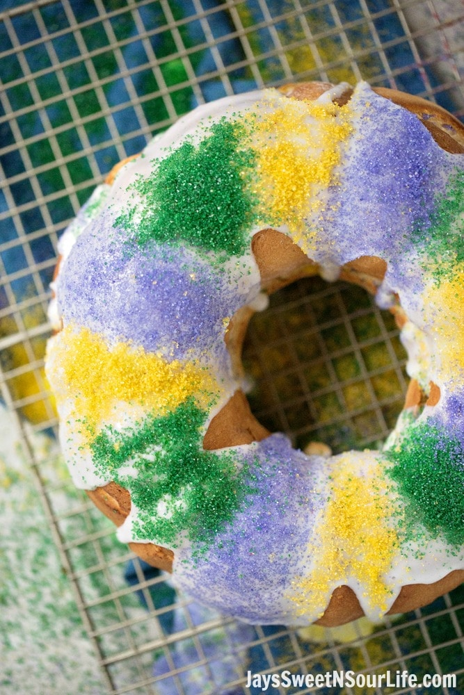 Mardi Gras King Cake Long Shot. Hands down one of my absolute favorite cake recipes. Create a festive cake that the whole family will love. Check out the full recipe to see what secret ingredient I use in my recipe.