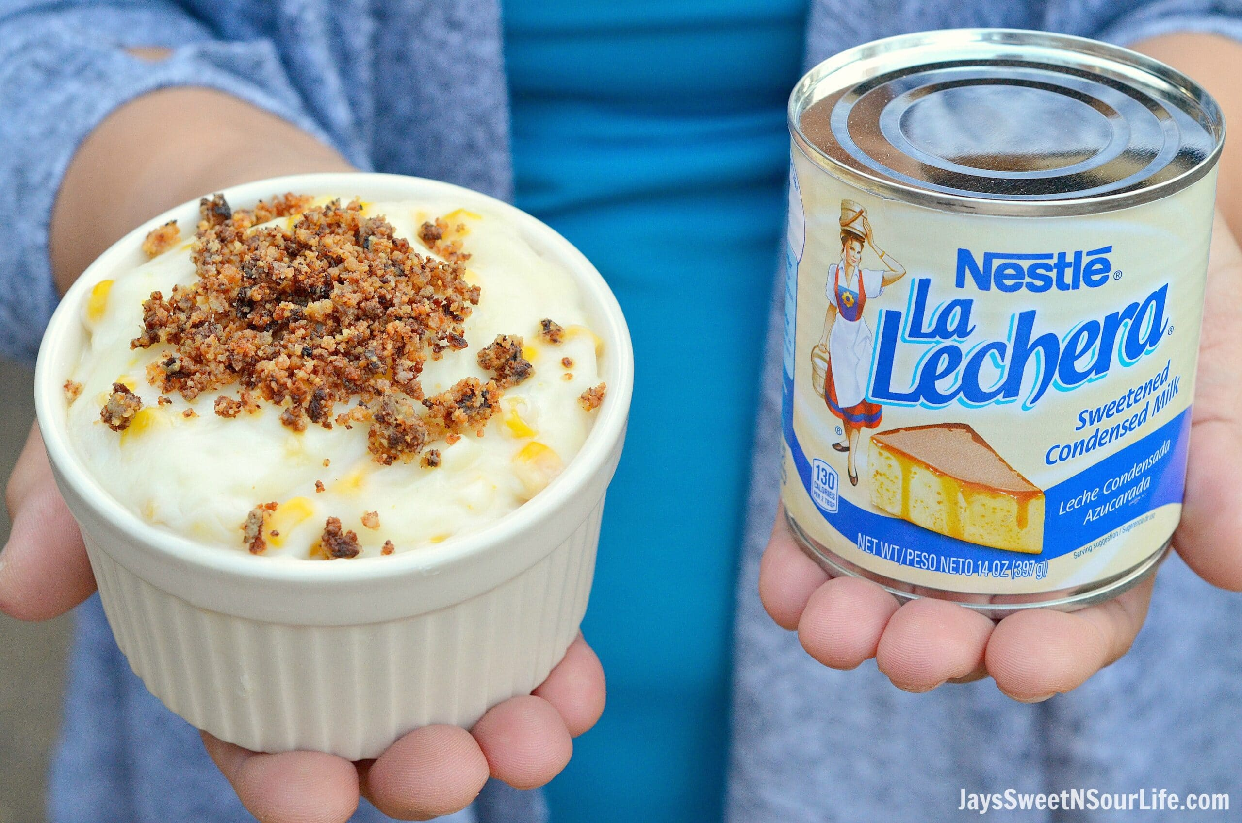 Maja Blanca Bowl In Hands With La Lechera. Maja Blanca is a popular Filipino dessert, it's thick creamy custard texture is sweet with bits of fresh yellow corn. Top it with fresh easy to make homemade Latik for a traditional Maja Blanca topping.