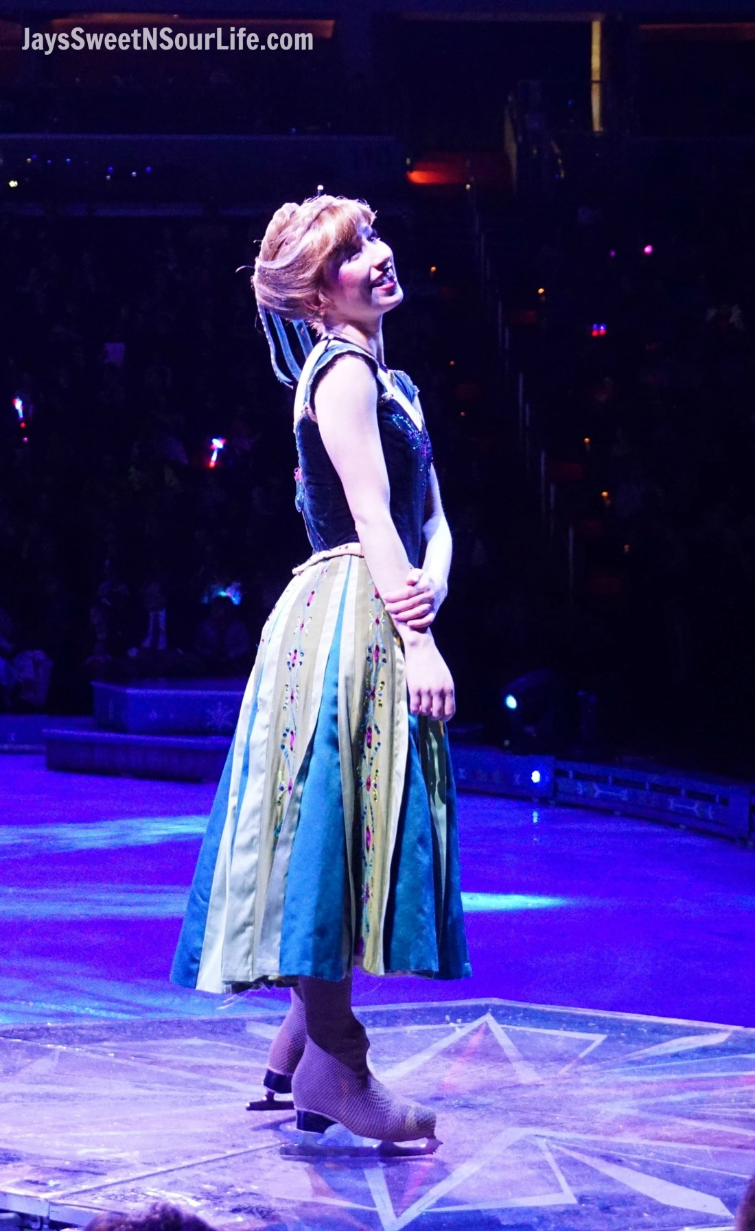 Disney On Ice Presents Frozen coming to a town near you. Ana stands on a sedistalto show off her dress and beautiful hair.