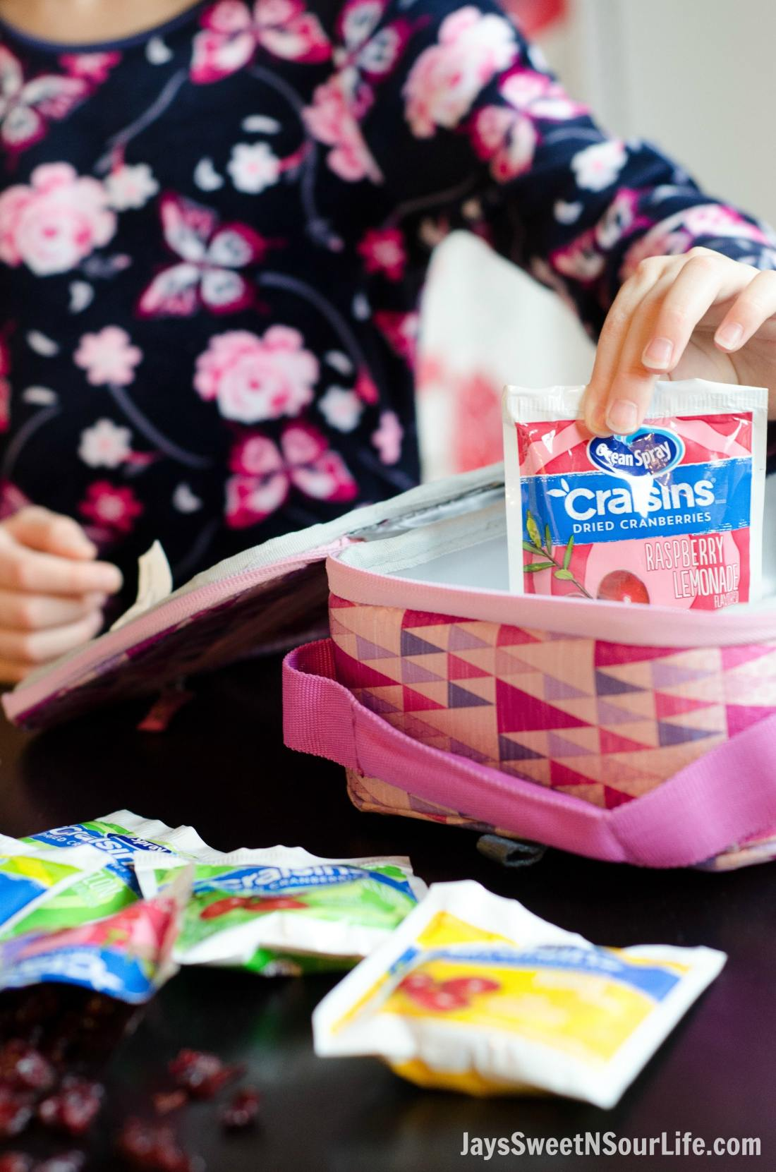 5 tips for the on the go mom. Little Girl Packing Ocean Spray Tropical and Fruit Splash flavored Craisins For school Lunch.