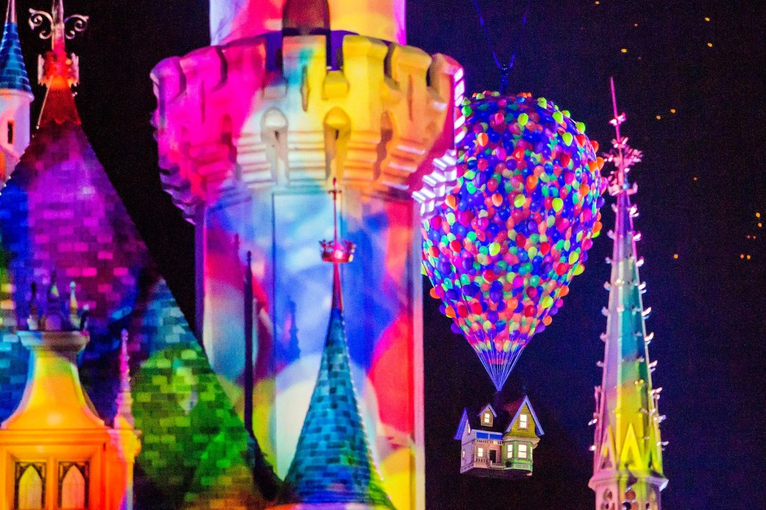 Together Forever – A Pixar Nighttime SpectacularTogether Forever shot of the castle and Up movie balloons and house. Pixar Fest offers many differnt shows and foods for guests to enjoy at Disneyland.
